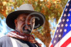 HR-USABS 00076 A Buffalo Soldier historical re-enactor standing close to a wrong era US flag historical re-enactor picture by Peter J  Mancus