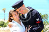 HR-WWIIUSN 00006 The camera captured eternal evidence of Cupid's well aimed arrows as a young US Navy World War II era sailor historical re-enactor relishes happiness with his girlfriend by Peter J Mancus