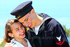 HR-WWIIUSN 00022 The camera captured eternal evidence of Cupid's well aimed arrows as a young US Navy World War II era sailor historical re-enactor relishes happiness with his girlfriend by Peter J Mancus