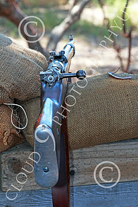HR-WWIGAS 00021 A WWI German Army bolt action rifle at rest on a sand bag, by Peter J Mancus