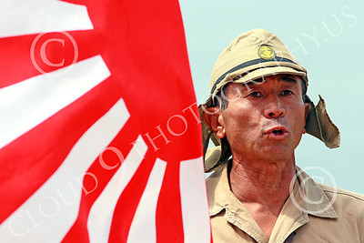 HR-WWIIIJS 00036 A tight crop of a World War II Imperial Japanese Army soldier sounds off while holding the Japanese rising sun flag, historical re-enactor picture by Peter J Mancus