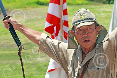 HR-WWIIIJS 00010 A World War II Imperial Japanese Army soldier with sword strikes a jubliant pose, historical re-enactor picture by Peter J Mancus