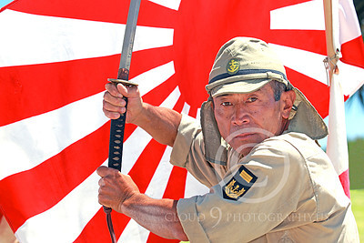 HR-WWIIIJS 00022 A zinger portrarit of a World War II Imperial Japanese Army soldier with sword before the Japanese rising sun flag, historical re-enactor picture by Peter J Mancus