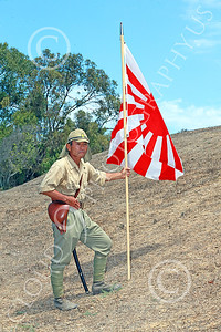 HR-WWIIIJS 00017 A World War II Imperial Japanese Army soldier with sword and pistol holds the Japanese rising sun flag on a stick, historical re-enactor picture by Peter J Mancus