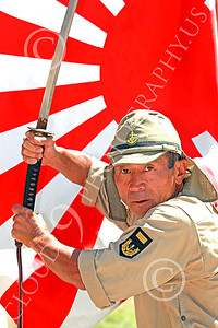 HR-WWIIIJS 00001 A World War II Imperial Japanese Army soldier with sword strikes a hositile position before the Japanese rising sun flag, historical re-enactor picture by Peter J Mancus