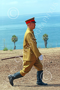 HR-WWIIIJS 00025 A World War II Imperial Japanese Army officer walks with a sword with the Pacific Ocean in the background, historical re-enactor picture by Peter J Mancus