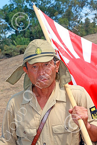 HR-WWIIIJS 00011 A World War II Imperial Japanese Army soldier holds the Japanese rising sun flag, historical re-enactor picture by Peter J Mancus