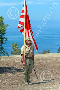 HR-WWIIIJS 00029 A World War II Imperial Japanese Army soldier holding the Japanese rising sun flag stands at attention with the Pacific Ocean in the background, historical re-enactor picture by Peter J Mancus