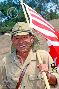 HR-WWIIIJS 00033 A happy World War II Imperial Japanese Army soldier with the Japanese rising sun flag, historical re-enactor picture by Peter J Mancus