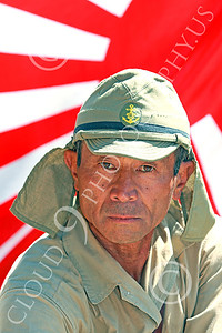 HR-WWIIIJS 00009 An impressive portrait of a World War II Imperial Japanese Army soldier with before the Japanese rising sun flag, historical re-enactor picture by Peter J Mancus