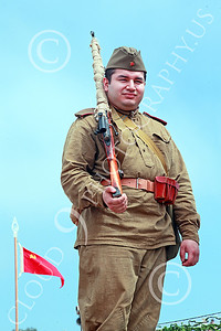 HR-WWIISAS 00001 A World War II Soviet Army sniper stands in front of the Soviet hammer and sickle flag, historical re-enactor picture by Peter J Mancus