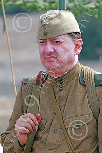 HR-WWIISAS 00017 Portrait of a reflective World War II Soviet Army soldier pondering his orders and the grim task ahead, historical re-enactor picture by Peter J Mancus
