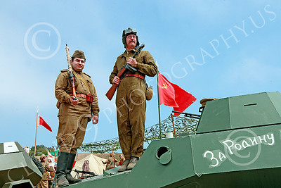 HR-WWIISAS 00016 Portrait of two armed male World War II Soviet Army soldiers standing on an armored vehicle, historical re-enactor picture by Peter J Mancus