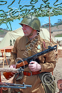 HR-WWIISAS 00029 Portrait of a helmeted World War II Soviet Army soldier with a sub-machine gun, historical re-enactor picture by Peter J Mancus