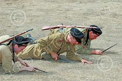 HR-WWIISAS 00006 Three male World War II Soviet Army soldiers poke the ground to find dangerous mines, historical re-enactor picture by Peter J Mancus