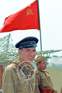 HR-WWIISAS 00007 A World War II Soviet Army soldier stands before the Soviet hammer and sickle flag, historical re-enactor picture by Peter J Mancus