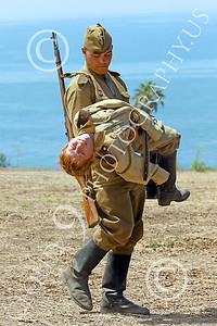 HR-WWIISAS 00003 A World War II Soviet Army soldier carries a wounded buddy to safety for medical care, historical re-enactor picture by Peter J Mancus