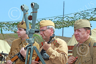 HR-WWIISAS 00008 Portrait of three male World War II Soviet Army soldiers in their camp behind field glasses on a tripod, historical re-enactor picture by Peter J Mancus