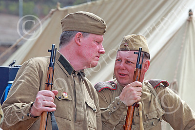 HR-WWIISAS 00010 Two male World War II Soviet Army soldiers with rifles in casual conversation, historical re-enactor picture by Peter J Mancus