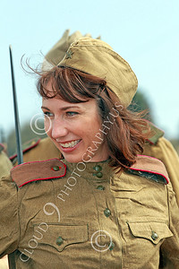 HR-WWIISAS 00025 Portrait of a World War II Soviet Army female soldier with a pretty smile, historical re-enactor picture by Peter J Mancus