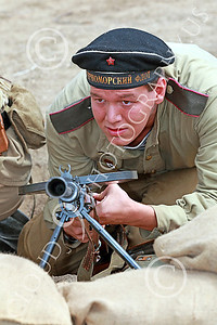 HR-WWIISAS 00009 A vigilant World War II Soviet Army machine gunner scans the battlefield for the enemy, historical re-enactor picture by Peter J Mancus