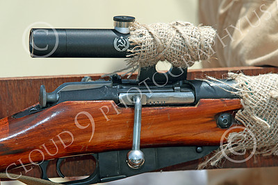 HR-WWIISAS 00024 A detail close-up of a simple, crude, non-beautiful, easy to mass produce, and effective World War II Soviet Army scoped sniper rifle, historical re-enactor picture by Peter J Mancus
