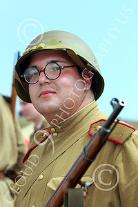 HR-WWIISAS 00015 A portrait of a bespeckled World War II Soviet Army soldiere with helmet and rifle, historical re-enactor picture by Peter J Mancus