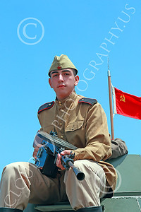 HR-WWIISAS 00027 Portrait of a young World War II Soviet Army soldier with a hand held machinegun sitting on top of an armored vehicle, historical re-enactor picture by Peter J Mancus
