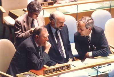 The New Zealand team consults during the UN General Assembly, 1987. From left: Deputy Minister of Foreign Affairs Frank O'Flynn, the Permanent Representative David McDowell, Secretary of Foreign Affairs Merwyn Norrish.  At back: the Deputy Permanent Representative Wade Armstrong.