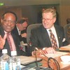 Commonwealth Heads of Government Meeting 1995. NZ Prime Minister Rt Hon Jim Bolger and Commonwealth Secretary General, HE Emeke Anyoku (Simon Murdoch, Secretary of MFAT, in background).