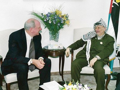 Special Envoy and Director for Middle East & Africa Michael Chilton and President of the Palestinian National Authority Yasser Arafat, 2001. This meeting was the first official dialogue with the Palestinian leader. The Israeli authorities had destroyed most of Arafat's compound, and the meeting took place in the only building remaining amongst the rubble.