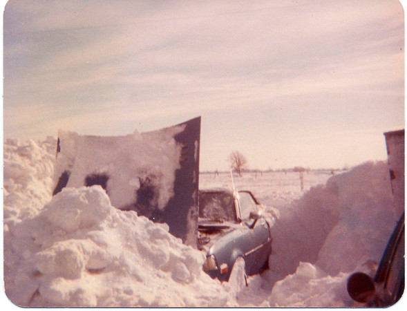 Jan 28, 1978<br /> Joretta Gibson of Kokomo with her 1977 Toyota barried in the snow at a friends house in Alexandria. After the car was unbarried the snow had to be removed from the engine compartment. The car started right up.<br /> Photo Provided