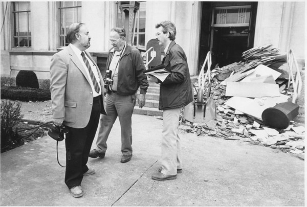 KT photo by Brian Reynolds<br /> Gerald Cittadine, Dimensions Inc., Clint Keller, an Indianapolis structural engineer, and Tim Miller, Dimensions Inc., confer outside of the courthouse after assessing the damage from the blast Thursday morning.