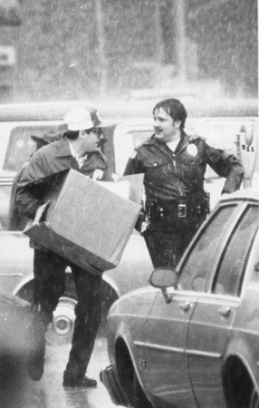 4/15/87<br /> KPD officer Orville Harness outside the courthouse bombing site.<br /> KT photo by Susan Goff