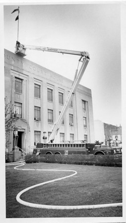 Photo by Brian Reynolds. 4/17/87. Howard County Courthouse bombing. Fire Dept. dumped between 200 and 250 gallons of water on the courthouse roof in a 5 minute period as part of a check for structural damage.