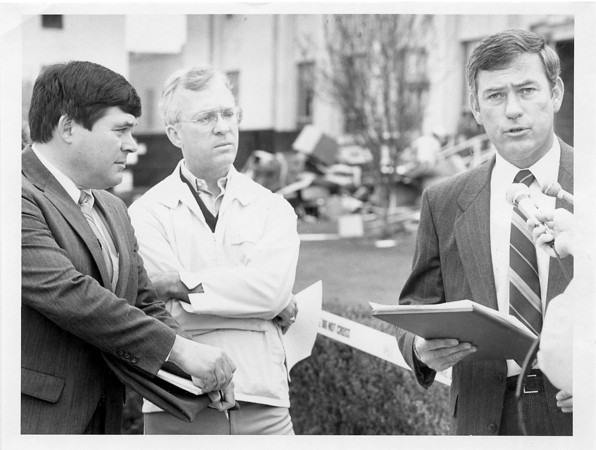 Photo by Brian Reynolds. 4/17/87. Robert Bly-Deputy Prosecutor, Ken Andrews-Deputy Prosecutor. and Jim Andrews at press conference on west side of courthouse.