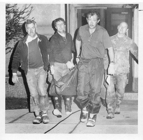 4/15/87 Howard County Courthouse bomb. Photo by Paul Sancya. KPD members take Robert Cray's body out of Howard County Courthouse at 2 a.m. Wednesday.