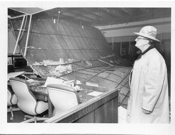 Photo by Brian Reynolds. 4/16/87. Courthouse bomb. Jon Zeck looks over commissioners room roof collapse.