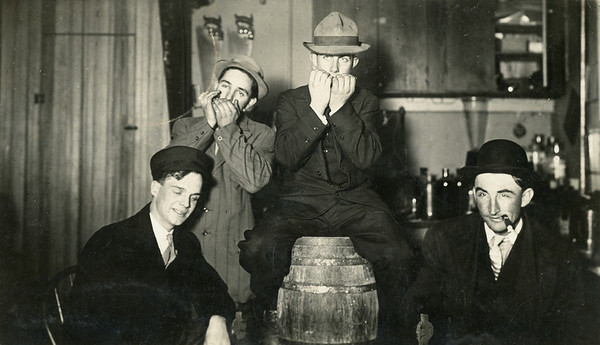 about 1910, left to right - Frank Rambo, Frank Grissell, Frank Beatty, Frank Wagoner, in back room of Fred Keopki's store, La Moille IL