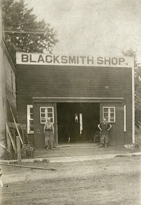 Blacksmith shop on the south side of what is now Hal Adkins Photo,  left - Henry Showalter, right - Ben Smith, La Moille IL