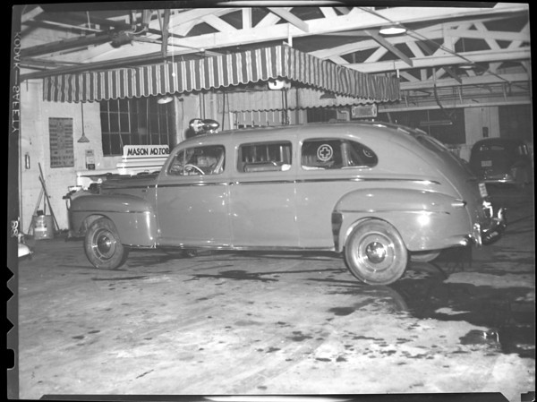 circa 1940<br /> St. Joseph Hospital Ambulance at Mason Motors<br /> KT file photo