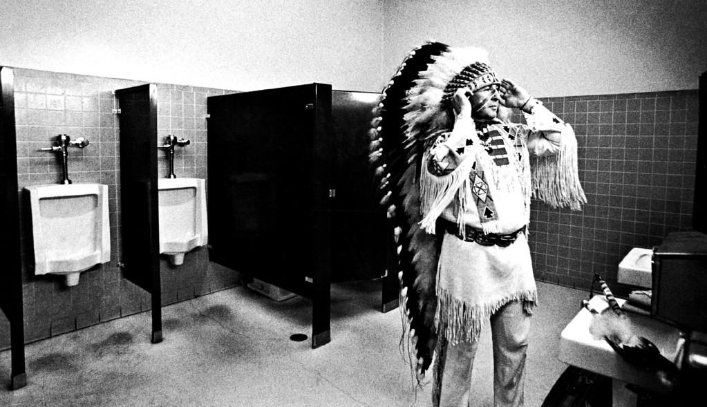 . Nighthorse, Ben Cambell, Ben dressing in the rest rooms above the arena.   (Anthony Suau/The Denver Post)