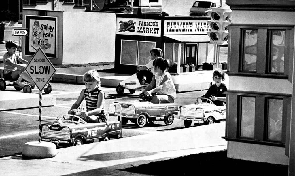 ". AUG 19 1973.  The cars are small, but the lessons big for children at Westland Shopping Center\'s 10th annual ""Safety Town\"" course.  (John Beard/Denver Post, Inc.)"
