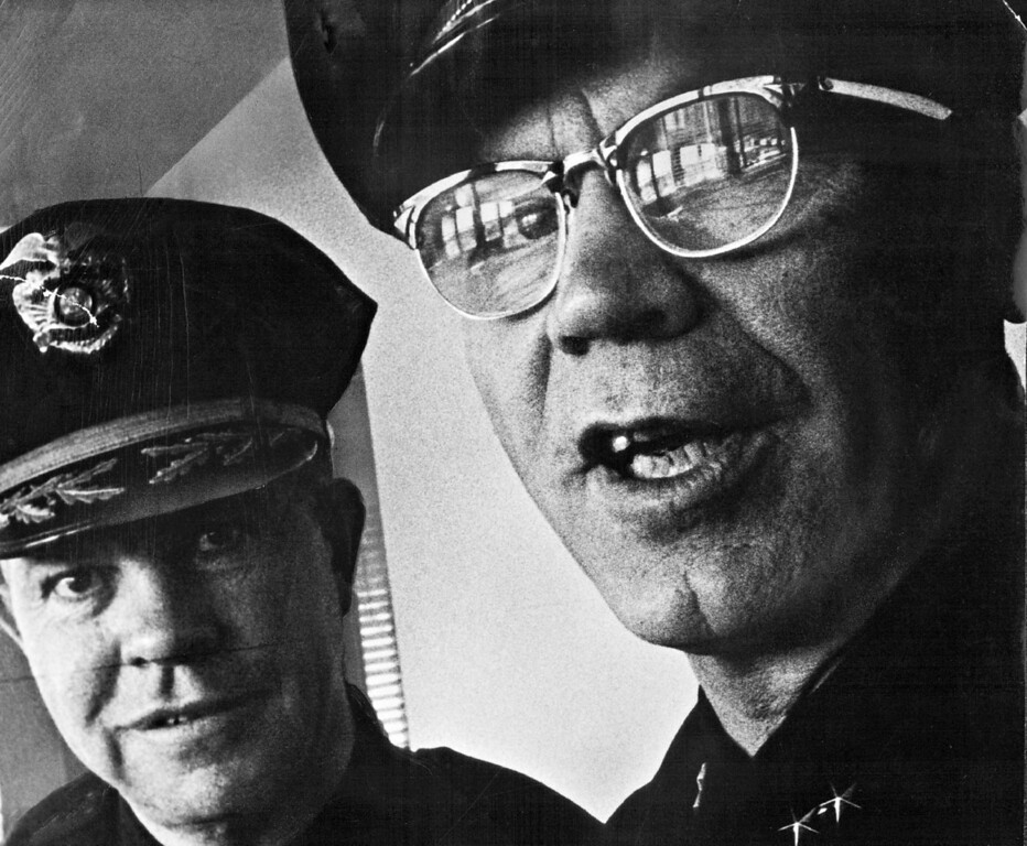 . NOV 21 1965. Police Capt. Frank Donovan, left, under the direction of Police Chief Harold Dill, right, and Mayor Currigan, has been given rank of division chief to supervise the Community Relations Bureau within the Police Department. (The Denver Post Archive)