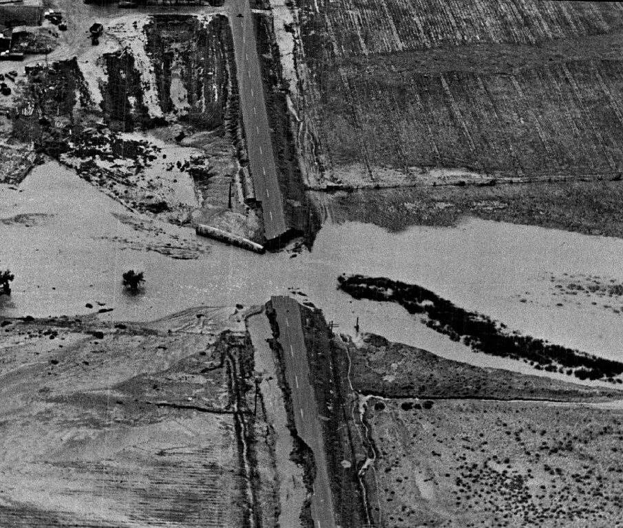 . 1965.   Horse creek has washed out the bridge on U.S. highway 50 about a quarter mile north of the Arkansas river and west of Las Angels.   (Cloyd Teter/Denver Post)