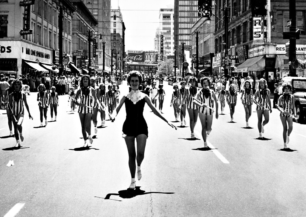 ". JUL 1 1961. The South Denver Twirettes march in ""Salute to America.\"" Batons keep rhythm in procession with bands, antique cars and horse patrol.  (Photo by David Mathias/Denver Post)"
