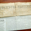 Tyler Rousseau, 11, and her mom May Riedel brought in a Fitchburg Sentinel & Enterprise from Friday March 8, 1844 that they have just bought for five dollars. SENTINEL & ENTERPRISE/JOHN LOVE
