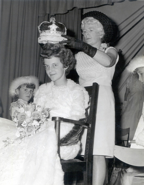 Mary Edge crowns Dorothy Settle as Rose Queen.