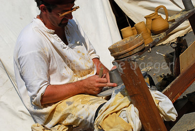 A potter at work in the medieval village during the Ommegang festivities in Brussels (Brussel), Belgium.