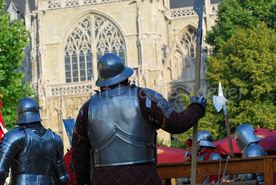 Knights in real plate armour and with real iron weapons in front of the Zavelkerk. It's all part of the events happening in the medieval village at the Place du Grand Sablon (Zavel) in Brussels, Belgium, during the Ommegang festivities.
